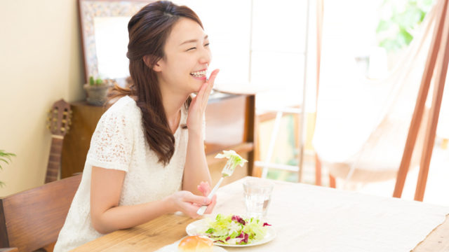 Japanese woman eating salad and bread